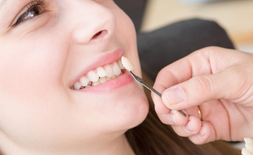 Dentist fixing little girl's broken tooth